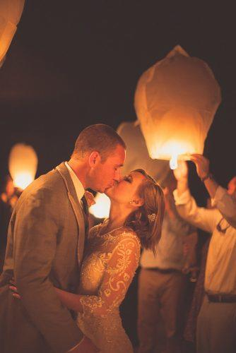 sky lanterns romantic kiss bride and groom city light studio