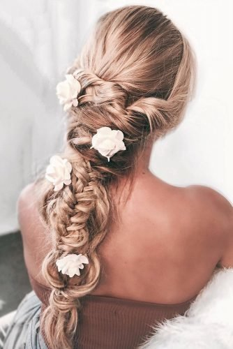 boho wedding hairstyles long blonde hair down with braids and white flower pins isabellajanehairmakeup
