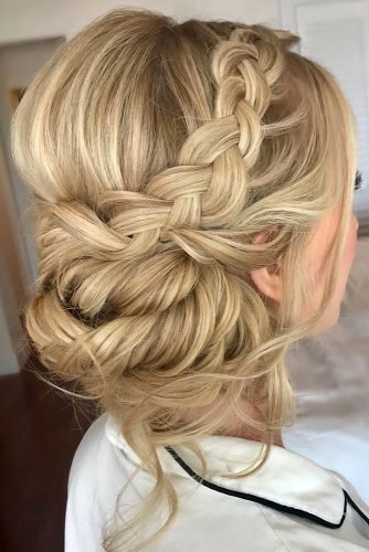 boho wedding hairstyles low slightly messy bun with side braid on blonde hair hairandmakeupido