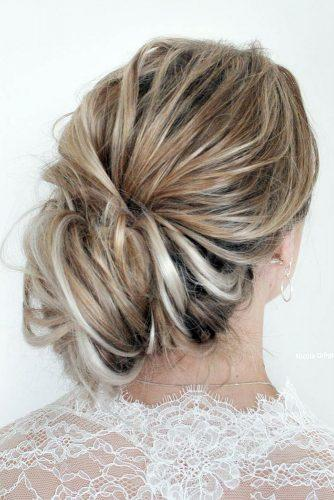 boho wedding hairstyles messy textured low textured updo nicoledrege