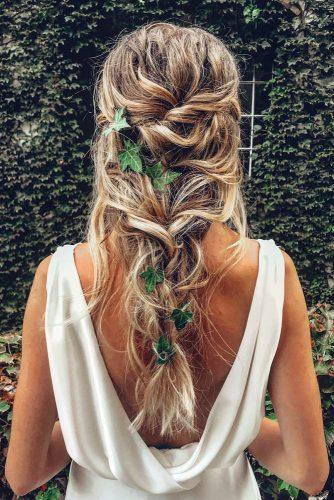 boho wedding hairstyles on long blonde hair down messy with green laves cruzmakeup