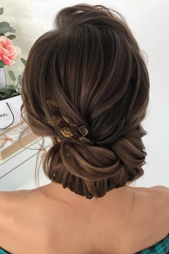 classical wedding hairstyles elegant textured low updo with golden leaves milabeautykim
