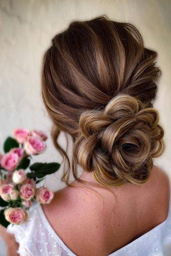 classical wedding hairstyles low flower shaped updo with samirasjewelry