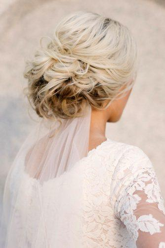 classical wedding hairstyles messy textured with bridal veil hair and makeup by steph via instagram