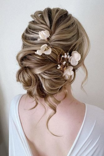 classical wedding hairstyles volume textured low with loose curls and white flowers pearly.hairstylist