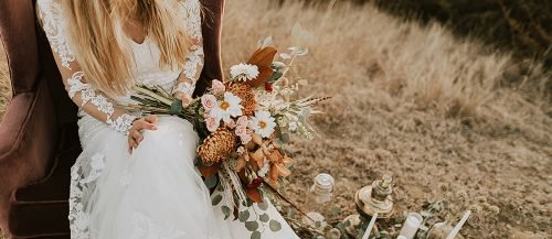 fall wedding colors bride boho with bouquets featured