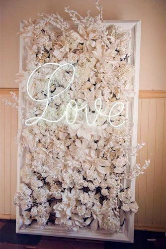2019 wedding trends flower backdrop with neon sign bellabloomsfloral via instagram
