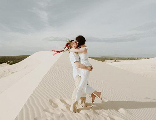 best places to elope sand married couple kiss