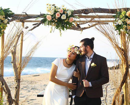 secret elopement beach wedding newlyweds