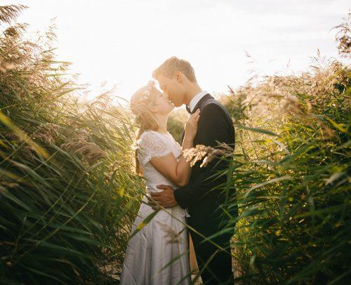 secret elopement bride and groom field