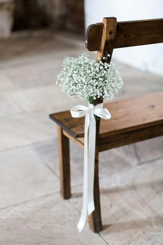 wedding aisle decoration ideas white stripe bow with baby breath flowers helen cawte photography