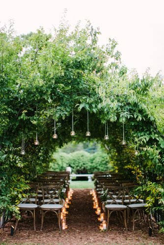 wedding aisle decoration ideas with simple candles under greenery tent mthreestudio
