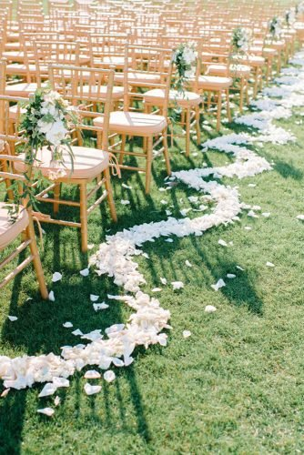 wedding aisle decoration ideas with wavy flower petals line pasha belman photography