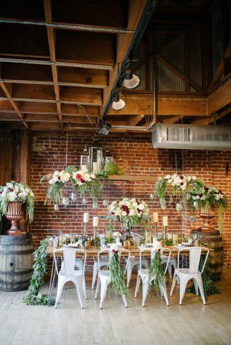 wedding loft décor rustic table decorated with greenery mr and mrs wedding duo