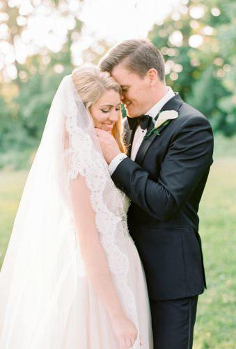 wedding photographers cute groom embrace laurenfair