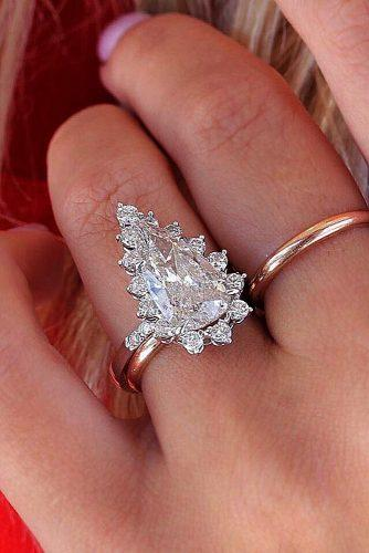 engagement ring inspiration pear cut halo snowflake unique