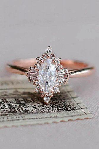 todays top engagement trends rose gold unique marquise cut halo