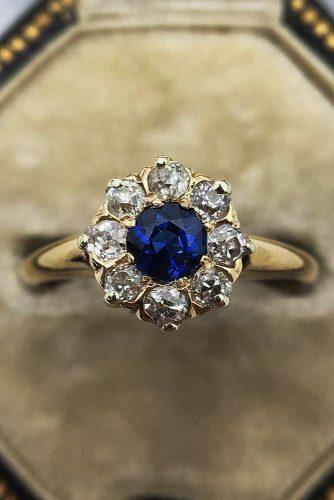 vintage engagement rings round cut sapphire floral halo yellow gold