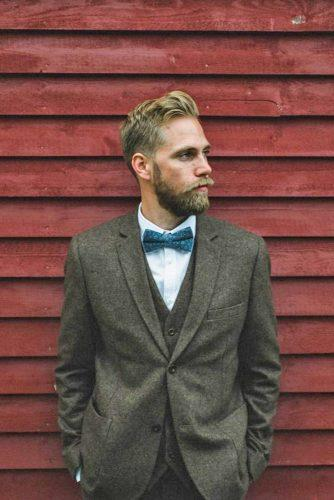 rustic groom attire tweed with butterfly jennifer moher photography