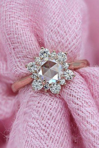 top engagement ring ideas floral halo round cut diamond rose gold moissanite