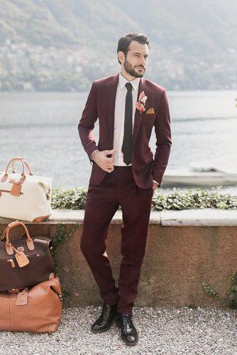 vintage mens wedding attire burgundy jacket with tie boutonniere catarinazimbarra photography
