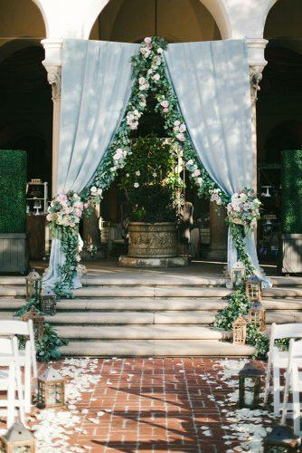 tiffany blue wedding decorations altar with cloth flowers and greenery onelove photography