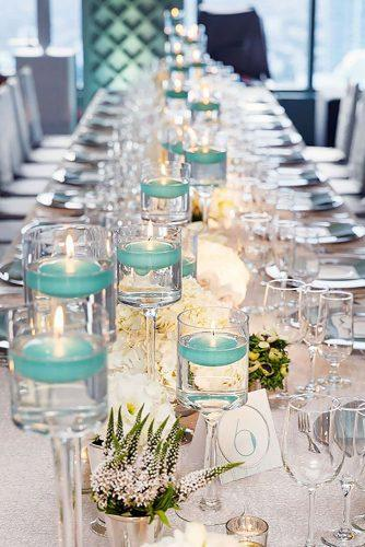 tiffany blue wedding decorations candels in glass with water colin cowie