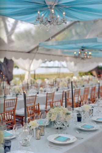 tiffany blue wedding decorations elegant reception under tent with white flowers and black candles liz banfield