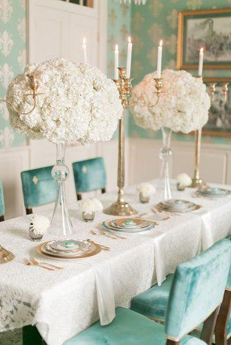 tiffany blue wedding decorations elegant reception with tall white flowers centerpieces and velvet chairs arte de vie