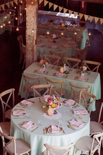 tiffany blue wedding decorations for rustic reception in barn with flowers and woodland table number on tables dreamlove photography