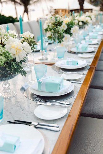 tiffany blue wedding decorations marble table with white flowers candles and tiffany boxes in plates mariasundinphotography