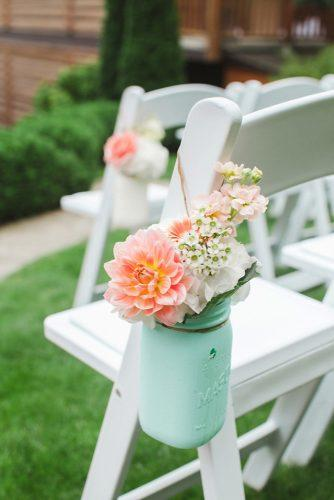 tiffany blue wedding decorations mason jar with peach flowers decorate the aisle brooke photography and design