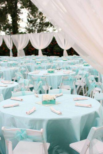 tiffany blue wedding decorations outdoor reception with round tables under blue tablecloth aaron snow photography