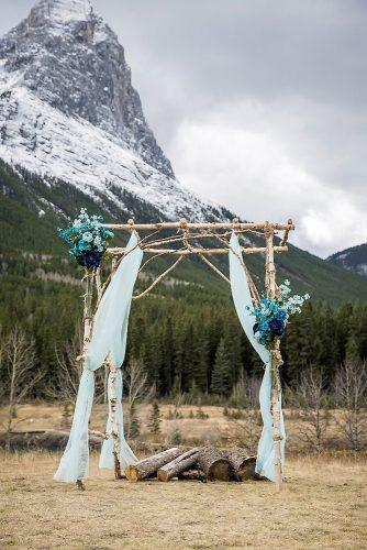 tiffany blue wedding decorations outdoor wedding altar with cloth and flowers kim payant photography