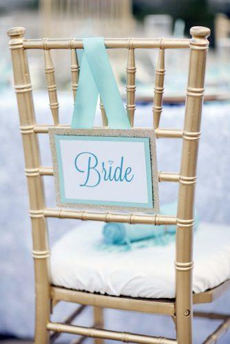 tiffany blue wedding decorations ribbons and bride sign decorate the table studio 11 weddings