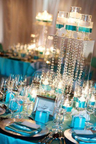 tiffany blue wedding decorations table with candles ribbons crystals and flowers visionari
