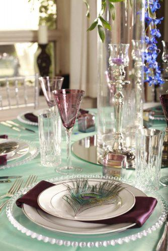 tiffany blue wedding decorations tadlecloth with dark lilac details and peacoc feathers inhouse studios