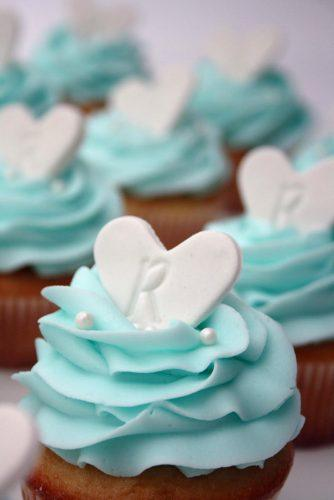 tiffany blue wedding dessert cupcakes with white hearts and cream and everything sweet