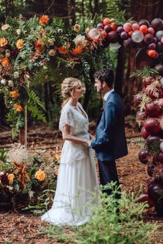 wedding ceremony decorations outdoor autumn with flowers and ballons brigitte & thierry photography