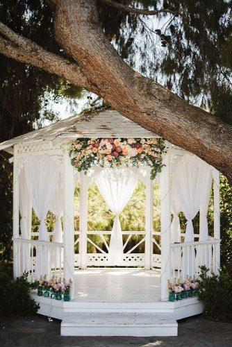 wedding ceremony decorations white wooden with flowers brit jaye photography