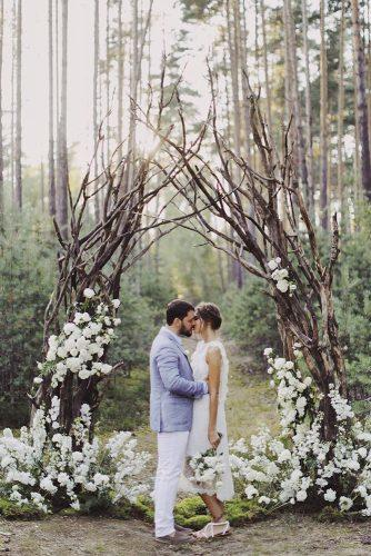 wedding ceremony decorations woodland with white flowers and brunches yaroslav_shuraev