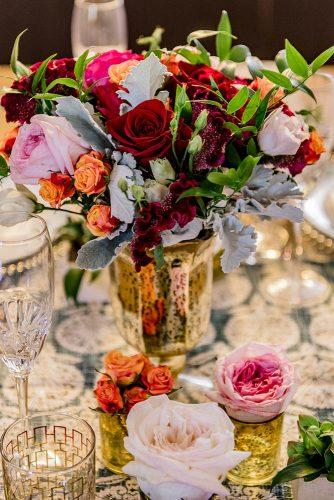 arabic wedding blowers in gold vase on wedding table madi photograph