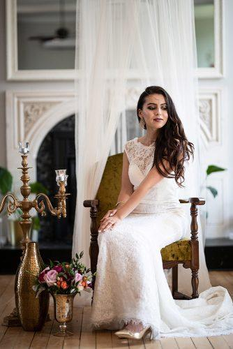 arabic wedding bride in lace dress and gold shoes seatins in armchair madi photograph