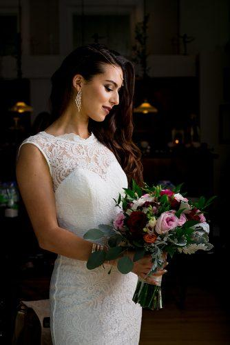 arabic wedding bride with bridal bouquet in lace wedding dress with accessories madi photograph