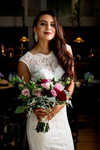 arabic wedding charming bridal look with loose dark hair and wedding bouquet madi photograph