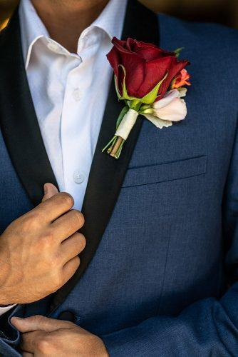 arabic wedding grooms look detail with red rose boutonniere madi photograph