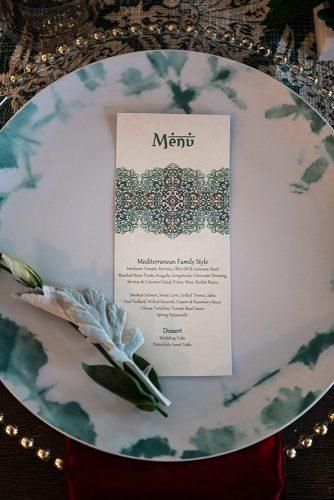 arabic wedding menu with blue oriental patterns and font on the plate Madi Photograph