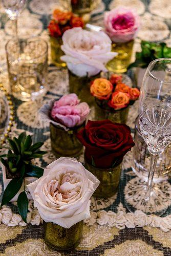 arabic wedding small vases with lonely roses on table madi photograph