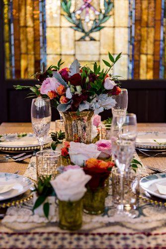 arabic wedding tablerunner and roses vases madi photograph