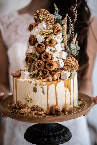 arabic wedding white drip cake with oriental sweets madi photograph